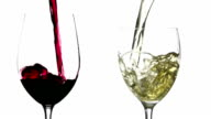 Slow motion pouring red and white wine on white background video
