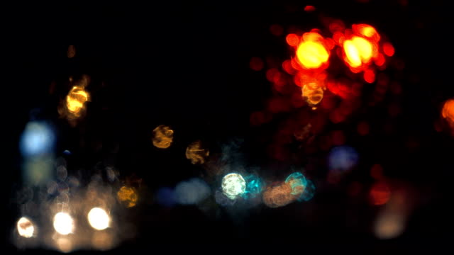 Slow Motion Rainy Night view From Inside a Car at a Red Traffic Light. video