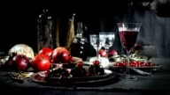 Slow motion red wine pouring into glass video