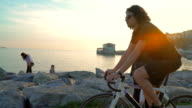 HD: Slow Motion Riding Bicycle at Sunset video