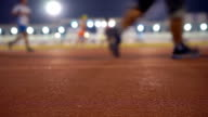 Slow Motion Running in track at Night with Floodlight Background video