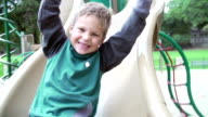 Slow Motion Sequence Of Boy Playing On Slide In Playground video