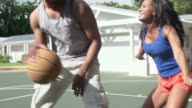 Slow Motion Sequence Of Couple Playing Basketball Match video