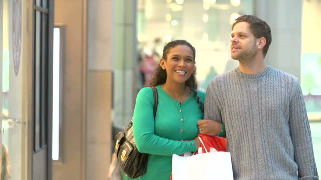Slow Motion Sequence Of Couple Shopping Mall In Mall video