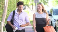 Slow Motion Sequence Of Couple Walking Along Street To Work video