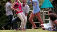 Slow Motion Sequence Of Families Playing In Garden Together video
