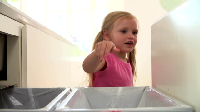 Slow Motion Sequence Of Girl Recycling Kitchen Waste In Bin video