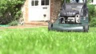 Slow Motion Sequence Of Man Cutting Lawn With Mower video