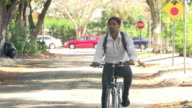 Slow Motion Sequence Of Man Cycling Along Street To Work video