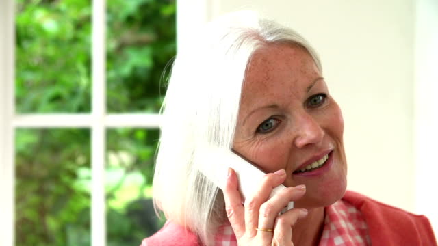 Slow Motion Sequence Of Middle Aged Woman On Phone video