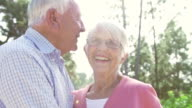 Slow Motion Sequence Of Senior Couple Embracing Outdoors video