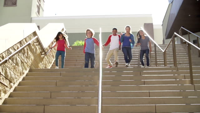 Slow Motion Sequence Of Teenagers Running Down Stairs video