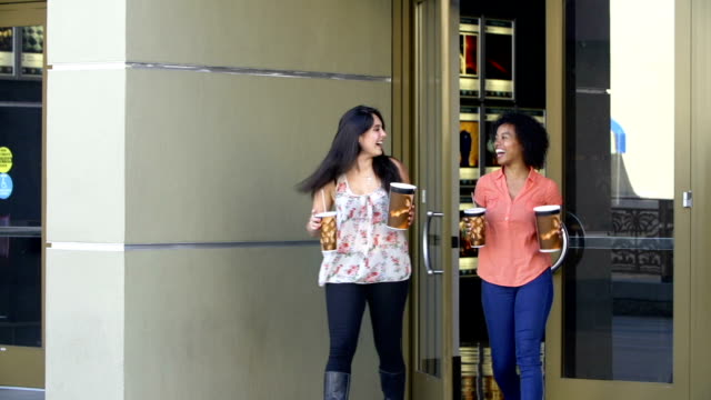 Slow Motion Sequence Of Two Female Friends Outside Cinema video