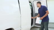 Slow Motion Sequence Of Van Driver Delivering Package video