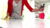 Slow Motion Sequence Of Woman Cleaning Surface In Kitchen video