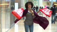 Slow Motion Sequence Of Woman Spinning Around With Bags video