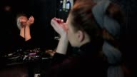 Slow motion shot of a beautiful young woman applying parfume video