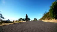 Slow motion shot of athlete sprinting along road outdoors video