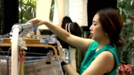 Slow Motion Shot of clothing shop owner arranging dresses video