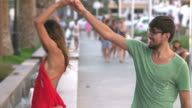 Slow Motion Shot Of Couple Dancing Along Street Together video