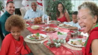 Slow Motion Shot Of Family Enjoying Christmas Meal At Table video