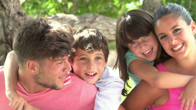 Slow Motion Shot Of Family Having Fun In Park Together video