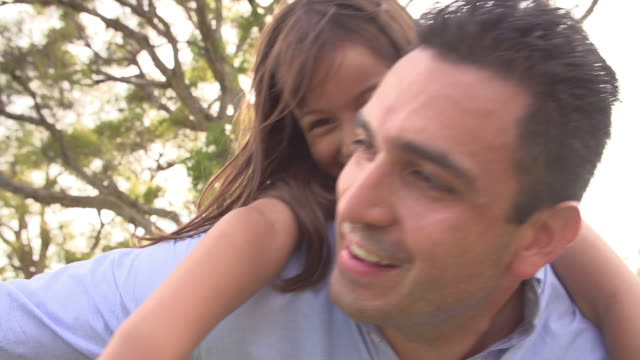 Slow Motion Shot Of Father Giving Daughter Piggyback Ride video
