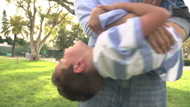 Slow Motion Shot Of Father Playing With Son In Park video
