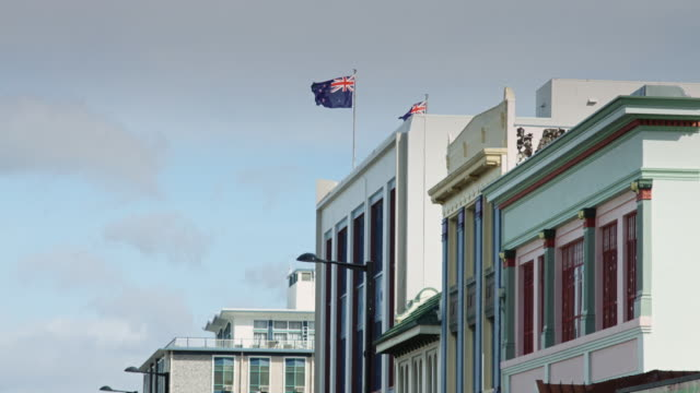Slow Motion Shot of Flags Flying Over Art Deco Napier Buildings video