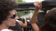 Slow Motion Shot Of Friends Dancing In Back Of Open Top Car video