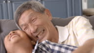 Slow Motion Shot Of Grandfather And Grandson Laughing video
