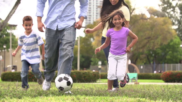 Slow Motion Shot Of Hispanic Family Playing Soccer Together video