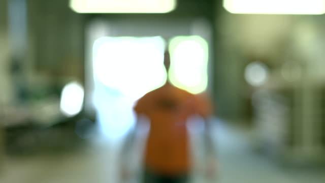 Slow motion shot of man walking up to camera video