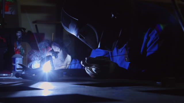 Slow Motion Shot of Metalworker Igniting and Using TIG Welder video