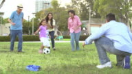 Slow Motion Shot Of Multi Generation Family Playing Soccer video
