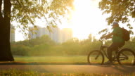 Slow motion shot of overweight man riding bike in the video