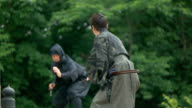Slow motion shot of Samurai and Ninja on the bridge. video