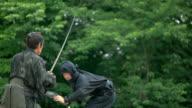 Slow motion shot of Samurai and Ninja on the bridge. video
