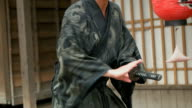 CU,Slow motion shot of Samurai with katana. video