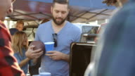 Slow Motion Shot Of Sports Fans Tailgating In Parking Lot video