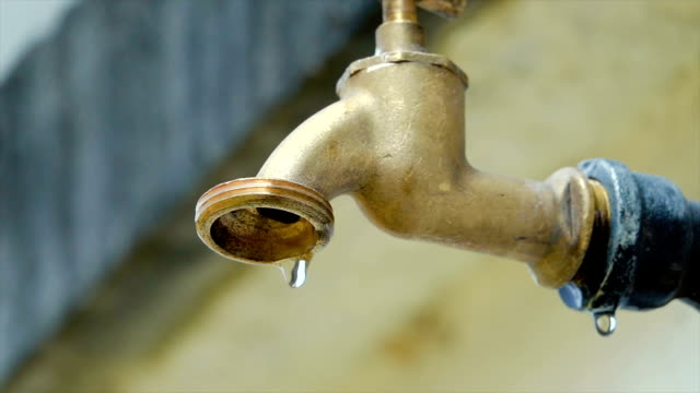 slow motion shot of water tap - faucet video