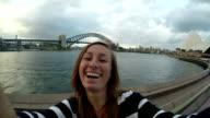 Slow motion shot of woman taking a selfie in Sydney video