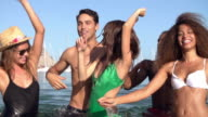 Slow Motion Shot Of Young Friends Having Fun In Sea Together video