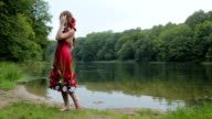 Slow motion shot. Portrait of girl with creative make-up in ethnic red dress video