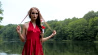 Slow motion shot. Portrait of mysterious girl with creative make-up video