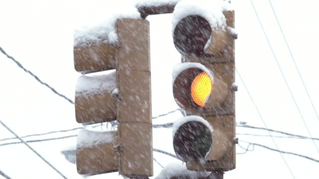 Slow motion snow on traffic light video
