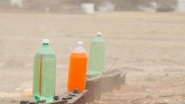 Slow Motion Soda Bottle Target Practice video
