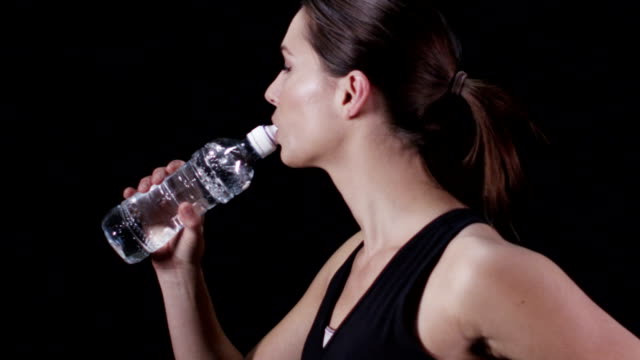 Slow motion sports woman and water video