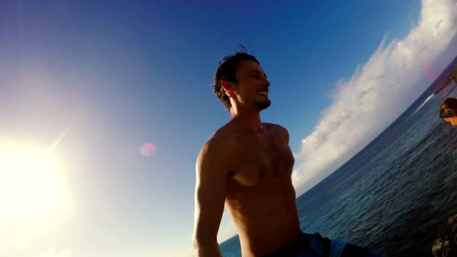 POV Slow Motion Sunset Cliff Jumping Backflip. Athletic Young Man Jumping From Cliff Into Ocean. video