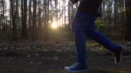 Slow motion: Sunset running in the forest video